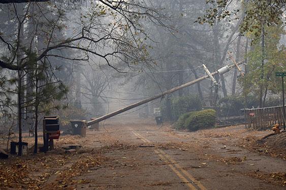 utility pole fallen across road