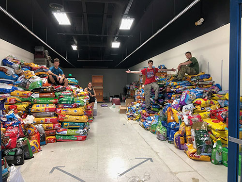 warehouse full of donated pet supplies