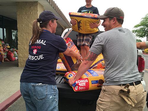 volunteers loading donations