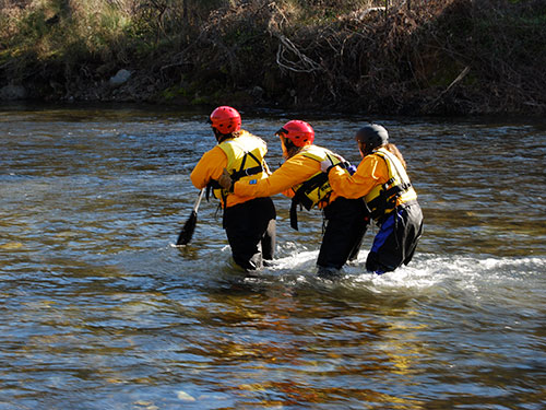 volunteers practicing water rescue