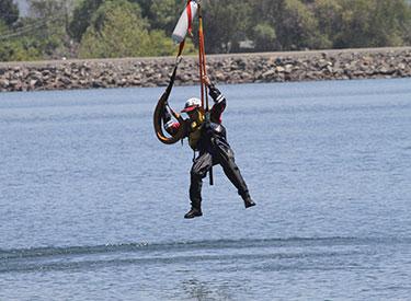 volunteer practicing a water rescue