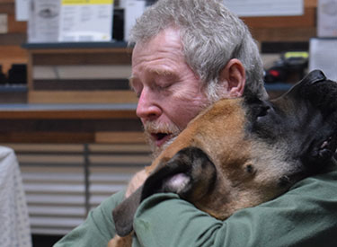 man reunited with rescued dog