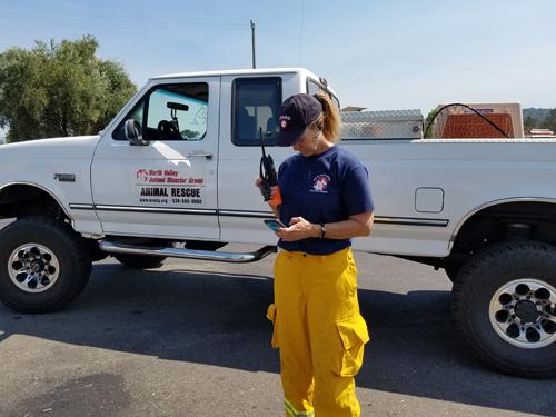 NVADG volunteer standing by evacuation truck