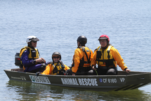 4 people in technical rescue boat