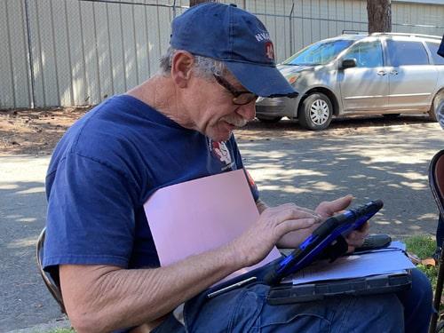 man working on Chromebook